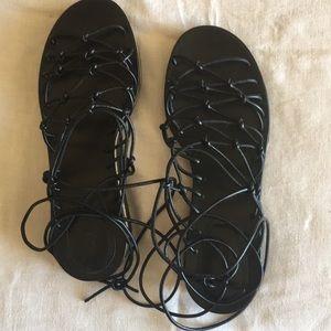 NWOT Chloe black leather lace up sandals.